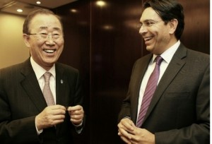 U.N. Secretary General Ban Ki-moon holds a nano Bible presented to him by Israeli envoy Danny Danon
